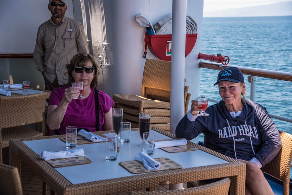 Guests aboard Yacht Isabela toasting to Darwin