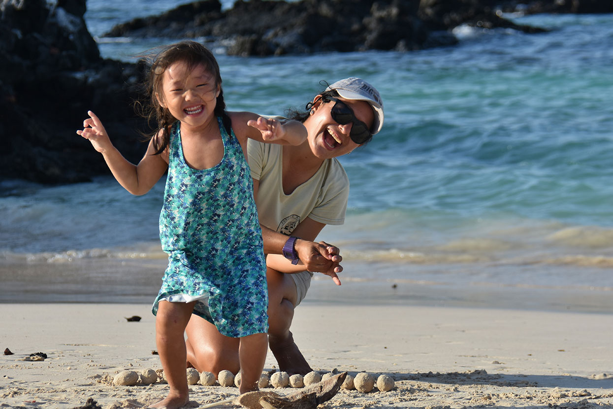 Family having fun at the shore